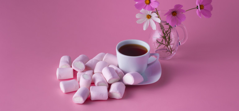 monochrome color scheme pink cup of tea and flowers