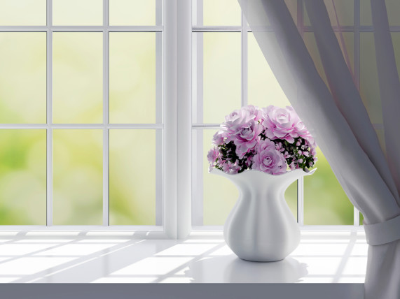 pink flowers in a white vase on a window sill