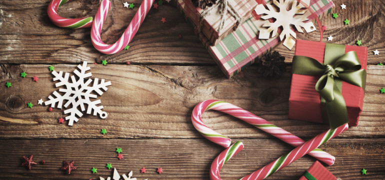 Merry Christmas presents candy canes wood table