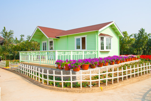 colorful house and gardens flower pots