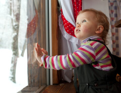 baby at window winter