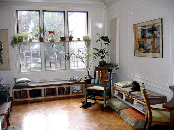 living room airy rocking chair wood floors natural light