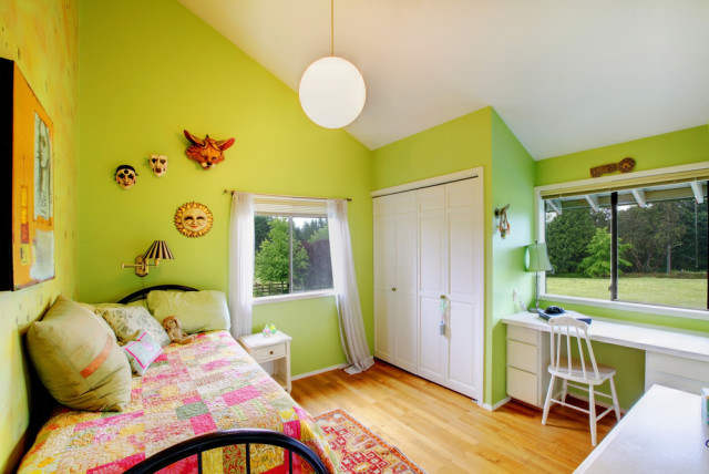 girls bedroom green walls wood floors