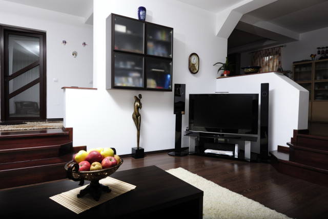 modern living room dark flooring sound system TV