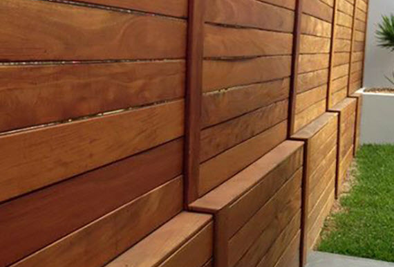 green lumber decking used as wood fencing
