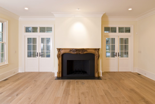 living room fireplace wood floors crown moldings
