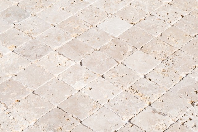 izmir-tumbled-travertine-classic-beige-tumbled-rustic-4x4-angle_1000