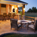 Outdoor kitchen and patio with fire pit