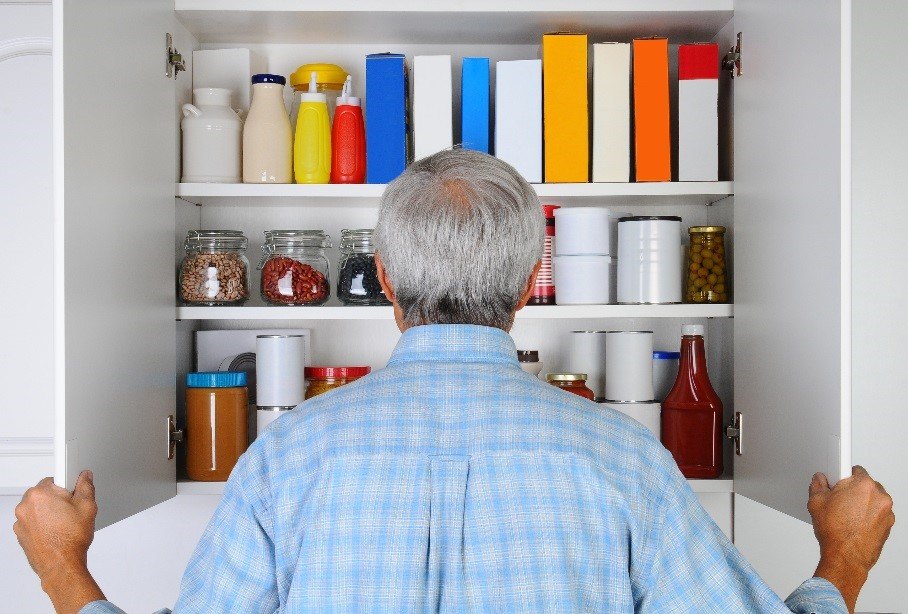 Man Looking in Pantry
