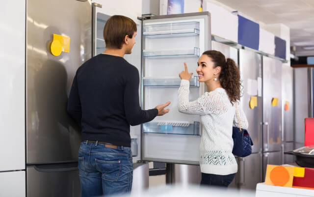 couple choosing fridge