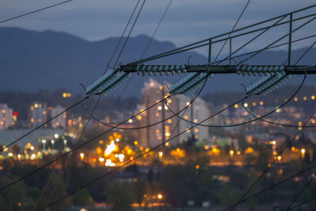 power lines with city backdrop