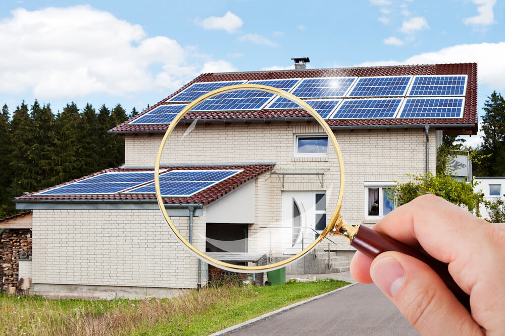magnifying glass over solar home