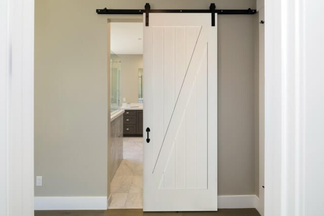 Primed 1-Panel Z-Bar Barn Door with Black Hardware SKU: 15206161