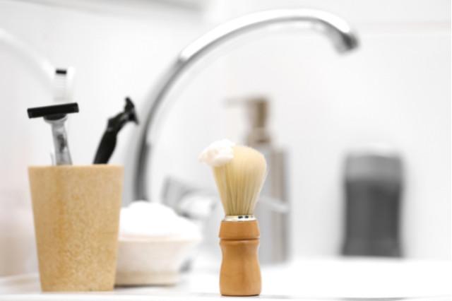 shaving at sink