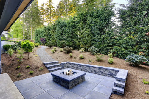 backyard with rectangular concrete fire pit